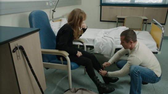 Kool Shen and Isabelle Huppert in ABUSE OF WEAKNESS