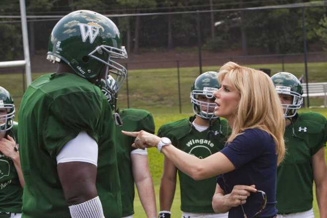 BS-15667 QUINTON AARON as Michael Oher and SANDRA BULLOCK as Leigh Anne Tuohy in Alcon EntertainmentÕs drama ÒThe Blind Side,Ó a Warner Bros. Pictures release.